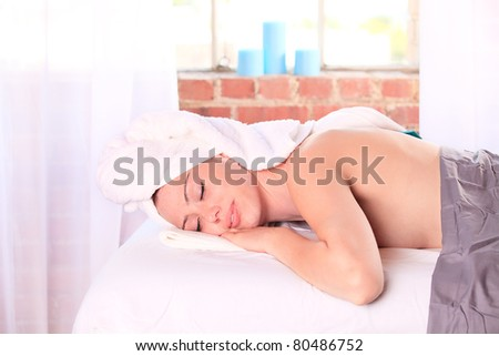 Woman getting a massge in a spa - stock photo