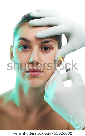 Woman getting an injection or hyaluronic, collagen,beauty treatment - stock photo