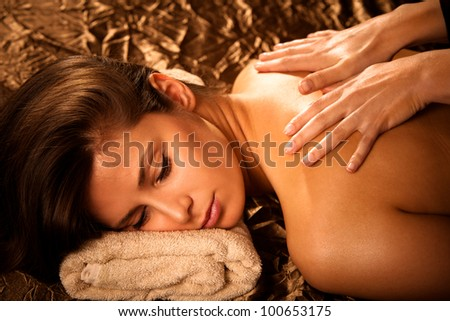 woman getting back  massage in spa salon - stock photo