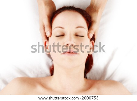 woman getting head and neck massage by therapist