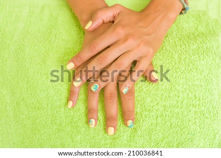 Woman getting her manicure done - stock photo