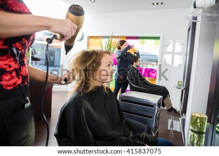 Woman Getting Her New Hairstyle In Salon - stock photo