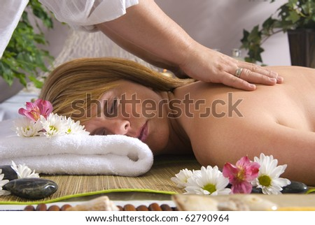 Woman getting massage at spa, focus on towel - stock photo