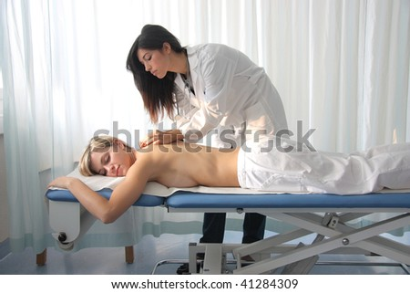 woman getting massage in a spa center - stock photo