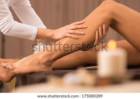 Woman Getting Massage Treatment - stock photo