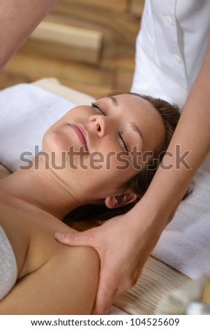 Woman getting neck massage at luxury spa centre - stock photo