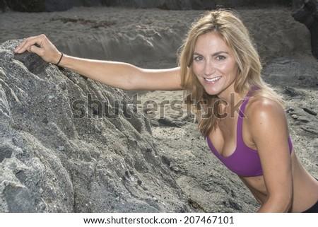 Woman getting ready for rock climbing/Woman Rock Climber/Woman in climbing attire ready to do rock climbing - stock photo