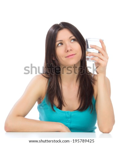 Woman getting ready to drink glass of drinking water. Healthy weight loss concept on a white background - stock photo