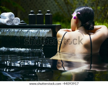 Woman getting spa treatment at tropical resort - stock photo