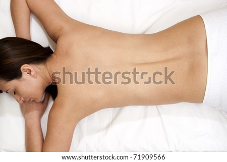 woman getting spa treatment isolated on white - stock photo