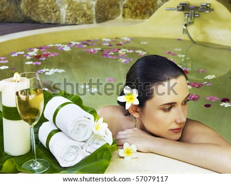 Woman getting spa treatment outdoor - stock photo