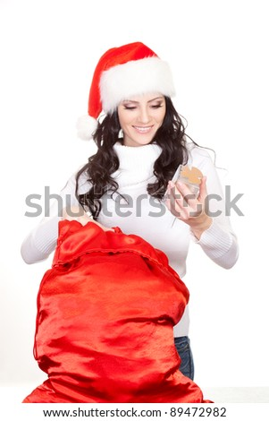 woman getting the gift from big red bag over white