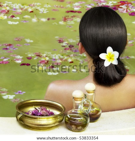 Woman getting treatment at spa centre - stock photo