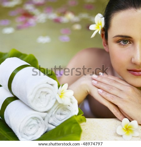 Woman getting treatment at spa centre. Focus on face. - stock photo