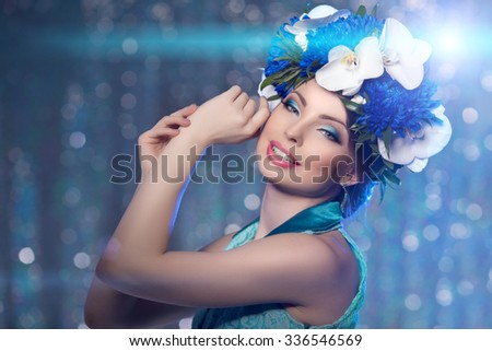 Woman girl wreath of flowers on head, lights party background  Hair Salon Fashion model with shiny healthy hair with luxurious haircut blurred bokeh, backlight. Creative bright makeup Jewelry Earrings
