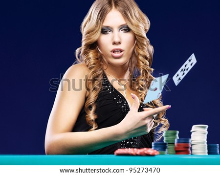 Woman give up in a card gambling match on blue background - stock photo