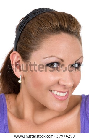 Woman gives a cute smile while turning her head sideways and looking out the corners of her eyes. - stock photo