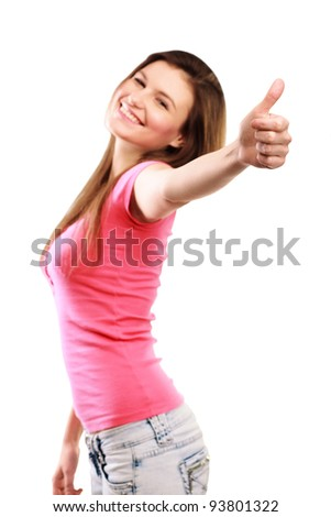 Woman gives thumb up against white background - stock photo