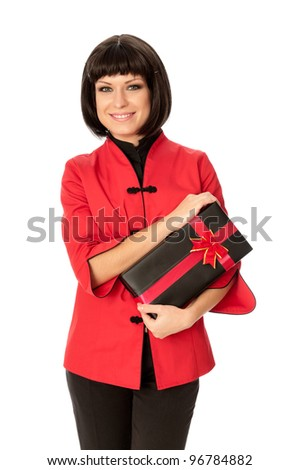 woman giving a black box with red bow as a gift - stock photo