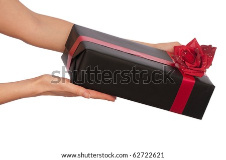 woman giving a black box with red rose as a gift - stock photo