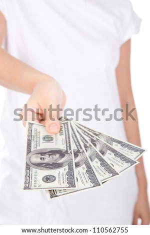 Woman giving a handful of dollars isolated on white background - stock photo