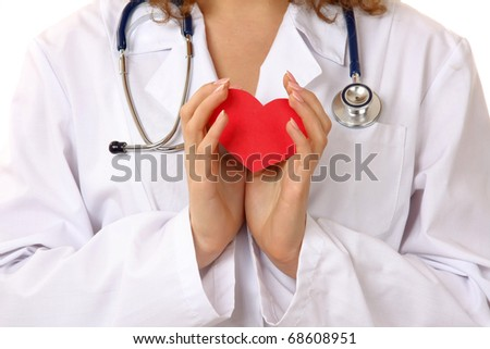 Woman giving a red heart - stock photo