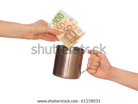 Woman giving donation euro money in the mug - stock photo