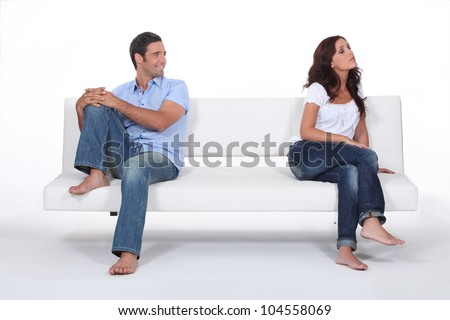 Woman giving her husband the cold shoulder - stock photo