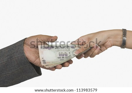 Woman giving money to a man - stock photo