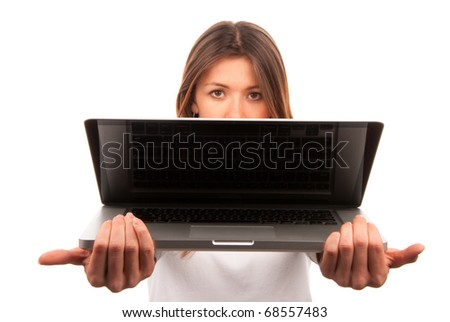 Woman giving new laptop computer to a customer isolated on a white background. Focus on laptop and hands - stock photo