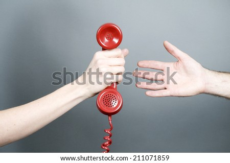 Woman giving phone to man