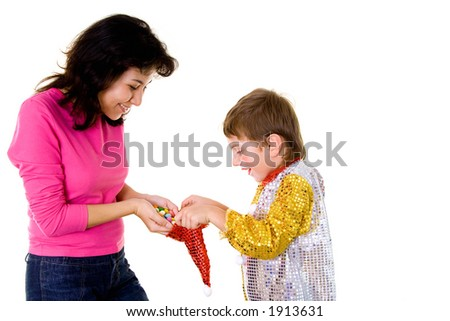Woman giving sweets to a boy-clown on halloween - stock photo