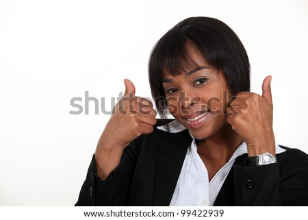Woman giving the thumb's up - stock photo