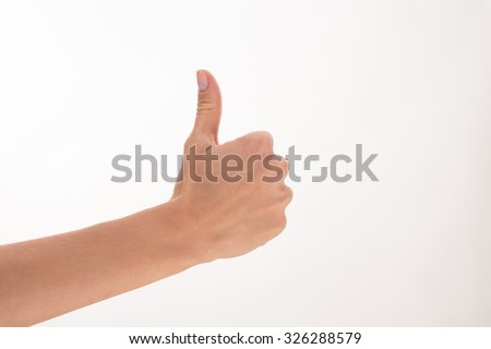 Woman giving thumb-up for showing success in the business life. Woman's right hand is nice idea for any poster. - stock photo