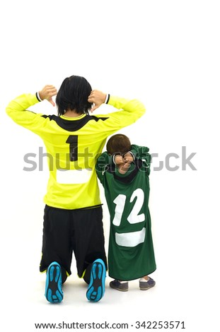 Woman goalkeeper and her little fan in studio showing their numbers - stock photo