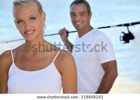 Woman going fishing with her husband - stock photo