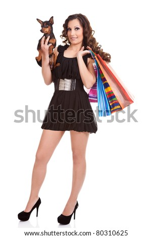 woman going in shopping with her miniature pinscher, trendy lifestyle, isolate on white - stock photo