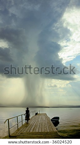 woman going to tornado ( photo ) - stock photo