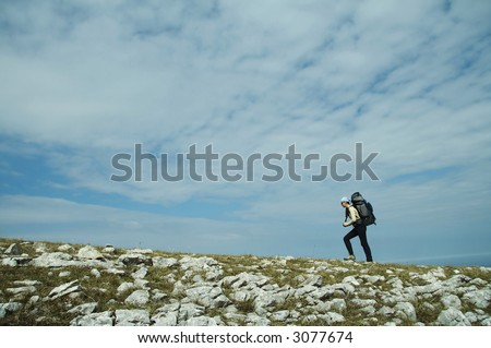 Woman going up alone  hill