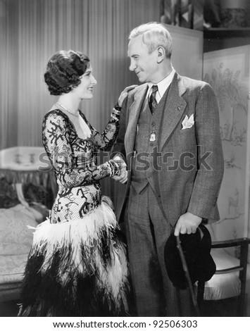 Woman greeting an older man - stock photo