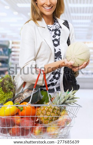 Woman grocery shopping  - stock photo