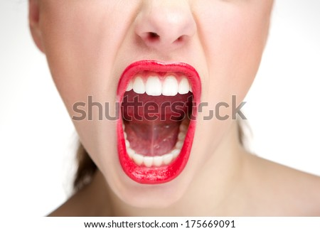 Woman half face shouting with mouth open and red lipstick - stock photo