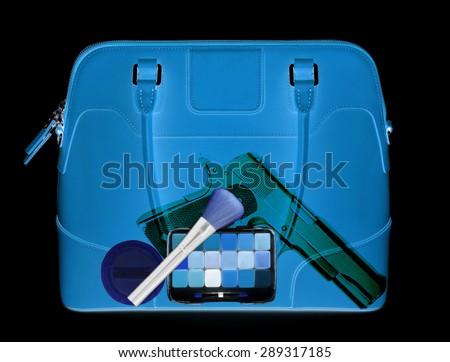 Woman hanbag under xray on security control. - stock photo