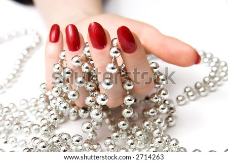 Woman hand and silver beads. - stock photo