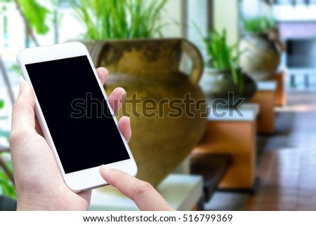 woman hand and touch screen smart phone