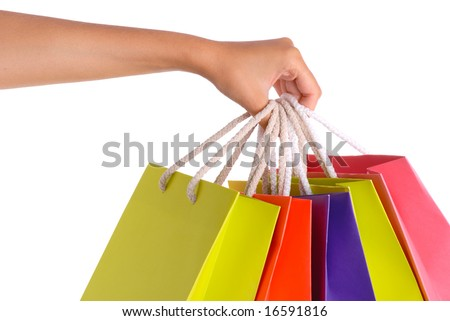 Woman hand carrying a bunch of shopping bags, isolated on white. - stock photo