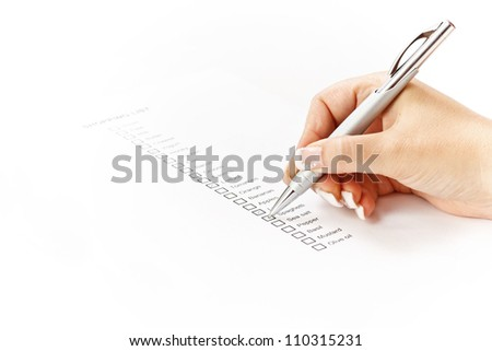 Woman hand checking a shopping list