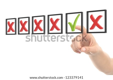 Woman hand checking tick and cross box on a white isolated background - stock photo