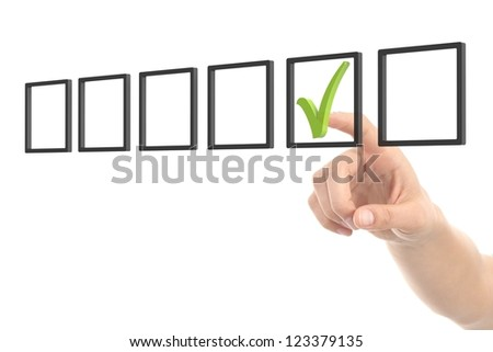 Woman hand checking tick box on a white isolated background - stock photo