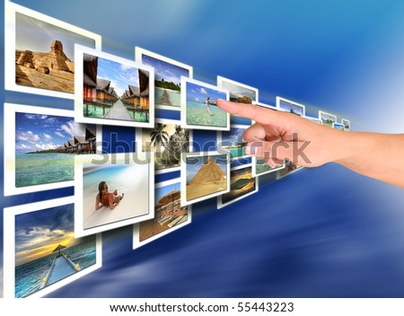 Woman hand choosing a holiday -  all pictures are coming from my gallery - stock photo